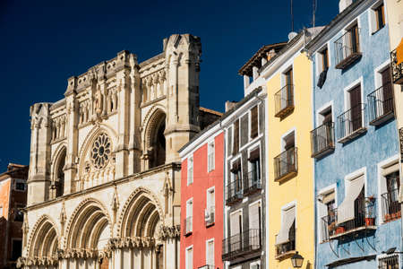 mancha: Cuenca (Castilla-La Mancha, Spain), facade of the medieval cathedral, in gothic style, and colorful houses Stock Photo