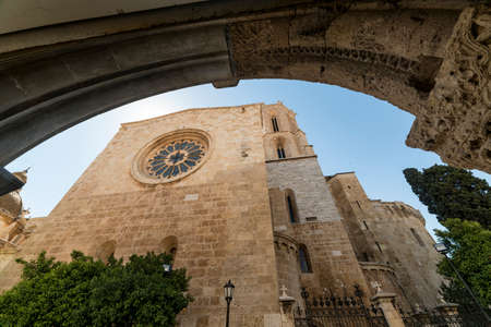 catalunya: Tarragona (Catalunya, Spain): exterior of the gothic cathedral seen through an arch of another gothic building