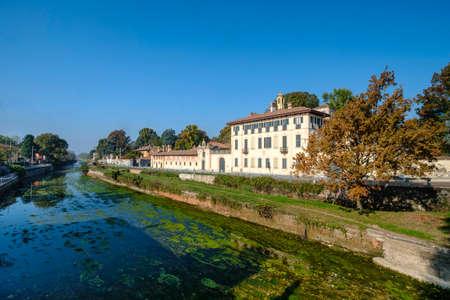 Cassinetta di Lugagnano (Milan, Lombardy, Italy): facade of the historic Villa Visconti Maineri along the canal known as Naviglio Grande of Turbigo