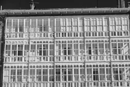 verandas: Burgos (Castilla y Leon, Spain): facade of historic building with balconies and verandas. Black and white