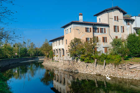 Country house along the Naviglio Grande of Turbigo (Milan, Lombardy, Italy) at fall, with geese