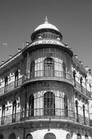 verandas: Salamanca (Castilla y Leon, Spain): facade of typical historic building, with balconies and verandas. Black and white