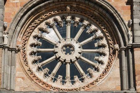 Avila (Castilla y Leon, Spain): facade of the historic Santa Teresa church: rose window Stock Photo