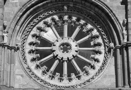 Avila (Castilla y Leon, Spain): facade of the historic Santa Teresa church: rose window. Black and white