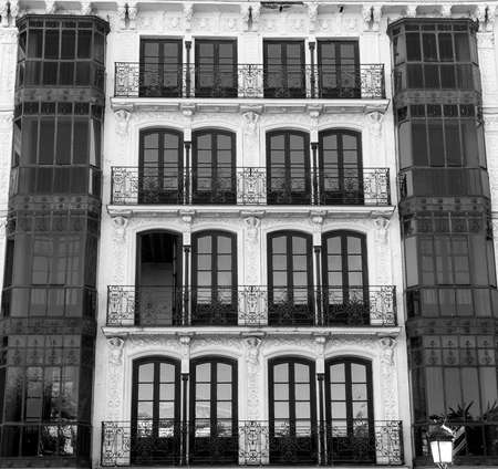 verandas: Toledo (Castilla-La Mancha, Spain): facade of historic building with balconies and verandas in the Zocodover square. Black and white