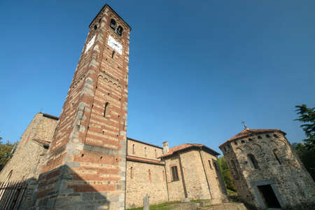 11th: Agliate Brianza (Monza, Lombardy, Italy): exterior of the medieval church of Saints Peter and Paul, built from the 11th century Stock Photo
