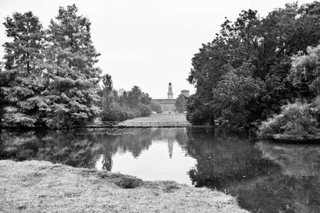 sforzesco: Milan (Lombardy, Italy): the Sempione park with Castello Sforzesco in background in a cloudy day of october. Black and white