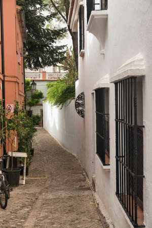 Ronda (Andalucia, Spain): old typical street with white houses Stock Photo