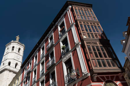 Valladolid (Castilla y Leon, Spain): historic buildings  with typical balconies and verandas, and the cathedral Editorial