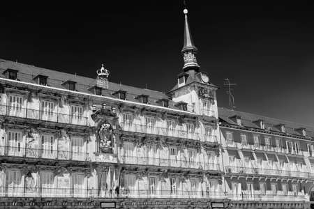 Madrid (Spain): facade of historic palace in Plaza Mayor, the main square of the city, known as Casa de la Panaderia. Black and white