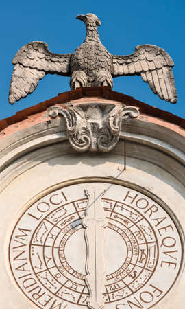 reloj de sol: Varese (Lombardy, Italy): the historic palace known as Palazzo Estense, hosting the town hall. Sundial and statue of eagle