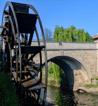 water mill: Groppello (Milan, Lombardy, Italy): the big wooden wheel on the Martesana canal known as Rudun and the old bridge