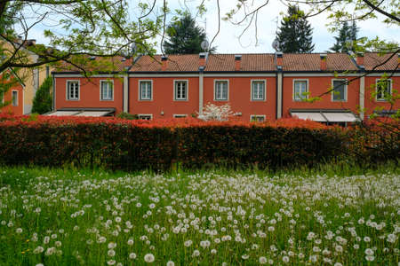 monza: Red facade of building along the bicycle path of the Lambro valley (Monza Brianza, Lombardy, Italy) at spring