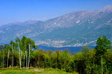 Madonna del Ghisallo, at top of the famous Ghisallo pass (Como, Lombardy, Italy). View of the Como lake (Lario). The Madonna del Ghisallo is the protector of the cyclists Imagens