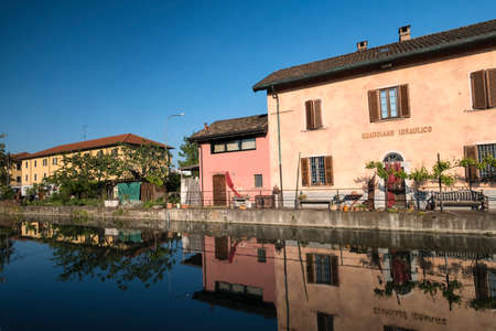 Cycling lane along the Naviglio Pavese, from Pavia to Milan (Lombardy, Italy) in the springtime. Old house of the Water Watchman Editorial