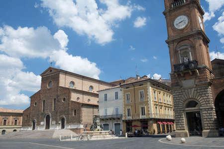 Faenza (Forli Cesena, Emilia Romagna, Italy): exterior of historic buildings: cathedral facade and fountain Stock Photo