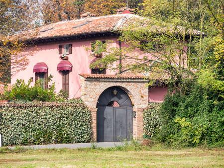 Bicycle path along the Naviglio Grande from Abbiategrasso to Turbigo (Lombardy, Italy), near Cassinetta di Lugagnano, at fall: old house Stock Photo