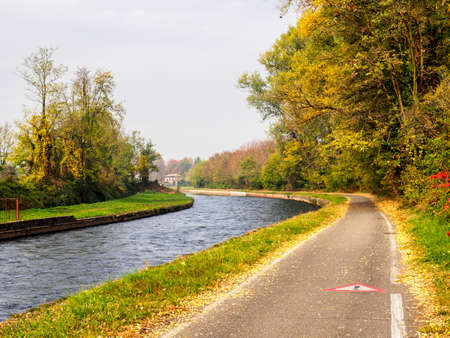 Bicycle path along the Naviglio Grande from Abbiategrasso to Turbigo (Lombardy, Italy), near Cassinetta di Lugagnano, at fall Stock Photo