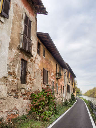 Bicycle path along the Naviglio Grande from Abbiategrasso to Turbigo (Lombardy, Italy), at Robecco sul Naviglio: old houses
