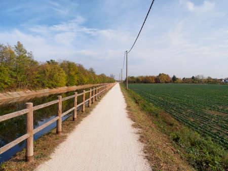 Bike path at Buscate (Milan, Lombardy, Italy) along the canal Villoresi at fall