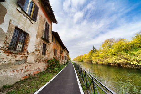 leonardo da vinci: Bicycle path along the Naviglio Grande from Abbiategrasso to Turbigo (Lombardy, Italy), at Robecco sul Naviglio: old houses