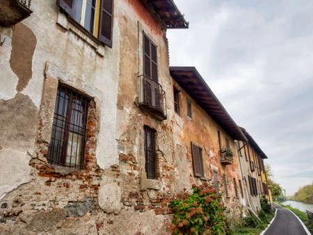 Bicycle path along the Naviglio Grande from Abbiategrasso to Turbigo (Lombardy, Italy), at Robecco sul Naviglio: old houses