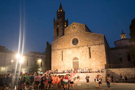 Teramo Abruzzi, Italy): the medieval cathedral (Duomo) at evening with young people Editorial