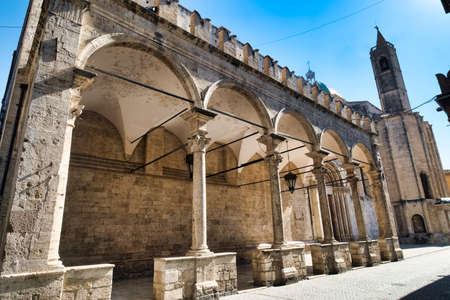 Ascoli Piceno (Marches, Italy): the famous Piazza del Popolo, the medieval main square of the city at morning. San Francesco church