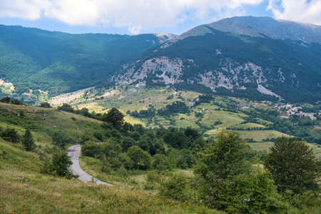 Mountain landscape along the road of Passo San Leonardo, in Maiella (Pescara, Abruzzi, Italy) at summer. View of the old village of Roccacaramanico