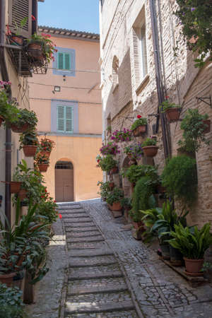 Historic buildings at the alley of Spello in medieval city of Perugia, Umbria, Italy. Stock Photo