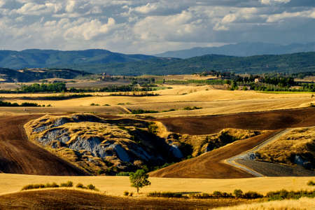 Country landscape along the road from Montepulciano to Asciano, Siena, Tuscany, Italy, at summer.