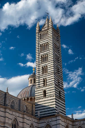 Historic buildings in SIena, Tuscany, Italy, at evening: exterior of the medieval cathedral (Duomo) Stock Photo