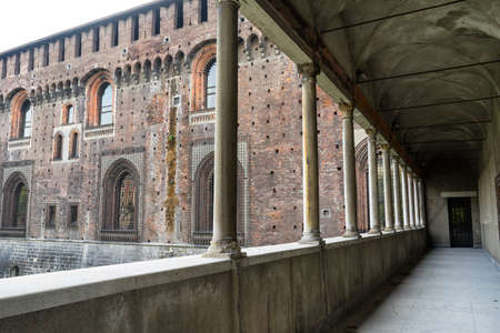 Milan, Lombardy, Italy: colonnade of the medieval castle known as Castello Sforzesco Editorial