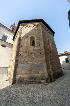 Oggiono, Lecco, Lombardy, Italy: the SantEufemia church, in baroque style, and the baptistery of San Giovanni Battista, in Romanesque style (11th century)