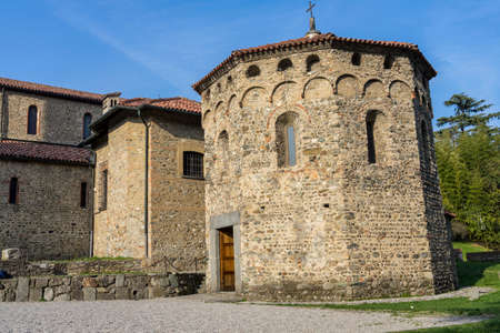 Agliate Brianza (Monza, Lombardy, Italy): exterior of the medieval church of Saints Peter and Paul, built from the 11th century: baptistery