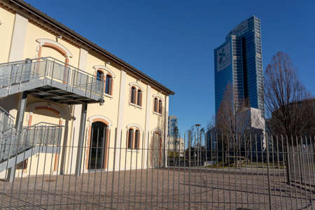 Milan, Lombardy, Italy: the modern Palazzo Lombardia seen from the park known as Biblioteca degli Alberi Stock Photo