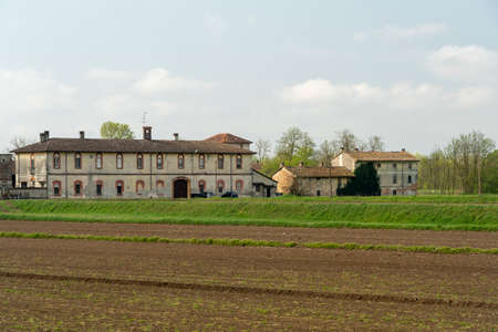 Old typical farm in the countryside of Pavia, Lombardy, Italy, in the springtime