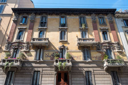 Milan, Lombardy, Italy: facade of an old typical residential building in art deco style along via Castelvetro