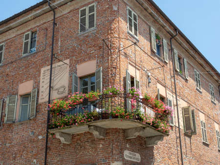 Crescentino, Vercelli, Piedmont, Italy: old palace with flowered balcony