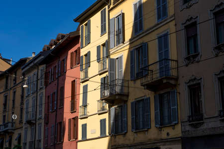 Milan, Lombardy, Italy: facade of old houses along via Mercato Редакционное