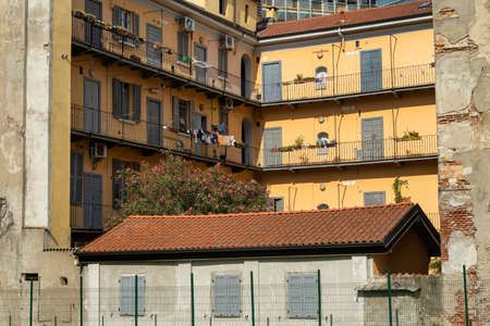 Milan, Lombardy, Italy: old typical residential building in the park known as Biblioteca degli Alberi, near the Gae Aulenti square Stock Photo