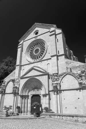 Exterior of the Abbey of Fossanova, Latina, Lazio, Italy, medieval monument. Black and white