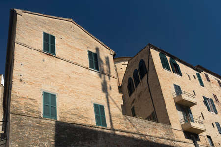 Macerata, Marches, Italy: a street of the historic city with the walls Archivio Fotografico