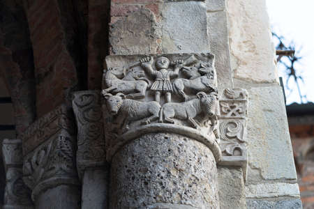 Milan, Lombardy, Italy: exterior of the medieval church of Sant Ambrogio. Facade. Detial of column