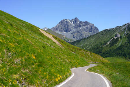 Mountain landscape along the road to Crocedomini pass, in the Brescia province, Lombardy, Italy, at summer.