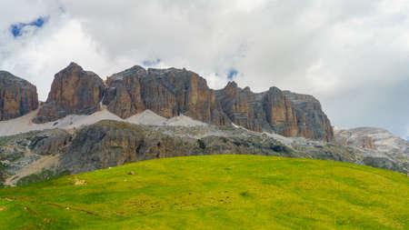 Mountain landscape at summer along the road to Pordoi pass, Dolomites, Trentino Alto Adige, Italy