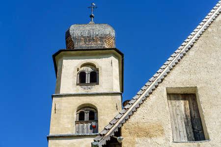 Medieval church of Santa Fosca at Pescul, Selva di Cadore, Dolomites, Belluno province, Veneto, Italy. Belfry