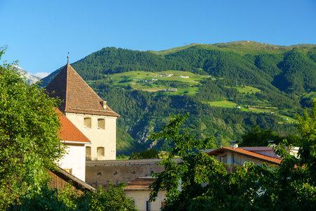 Glorenza, or Glurns, Bolzano, Trentino Alto Adige, Italy: historic city in the Venosta valley. Tower and landscape at morning