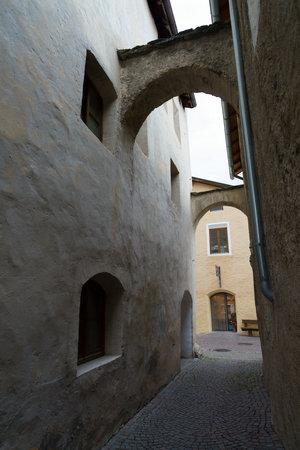Glorenza, or Glurns, Bolzano, Trentino Alto Adige, Italy: historic city in the Venosta valley. Alley with arch