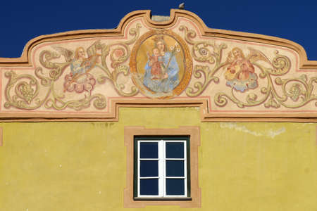 Glorenza, or Glurns, Bolzano, Trentino Alto Adige, Italy: historic city in the Venosta valley. Yellow building against blue sky